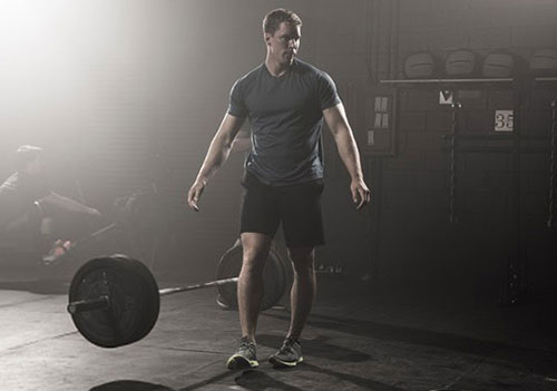 man-dropping-barbell-after-workout